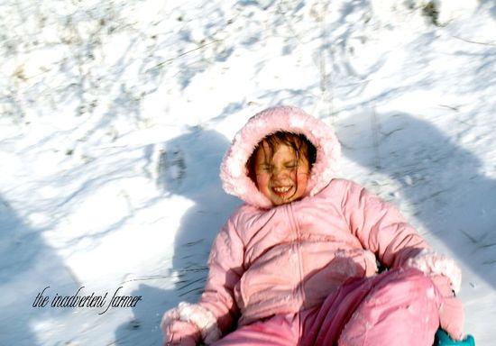 Sledding pink girl1