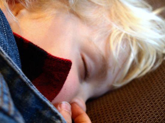 Nose picking boy sleeping
