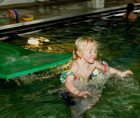 Swimming boy jump