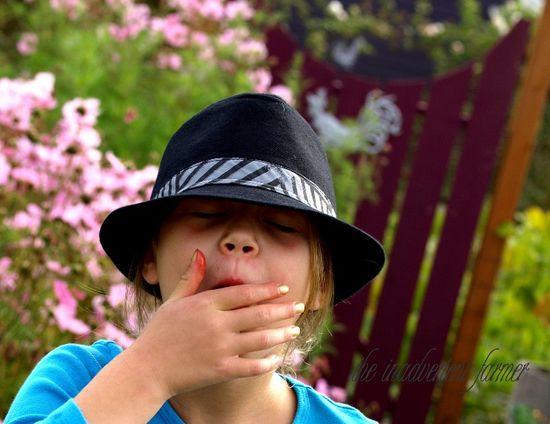 Girl black hat eat garden