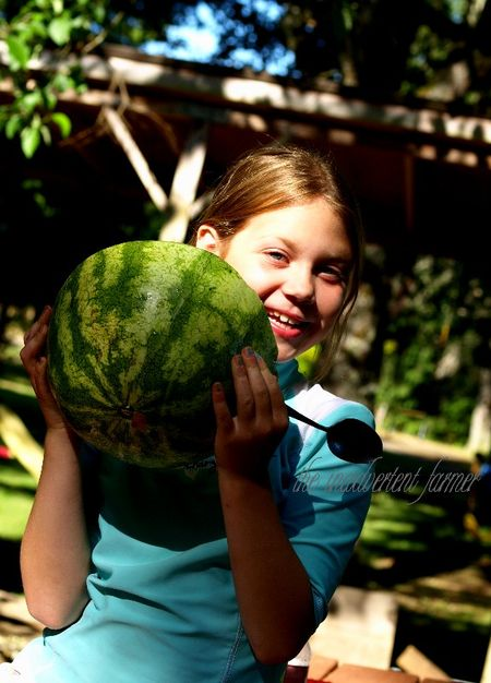 Girl smiling eating watermelon