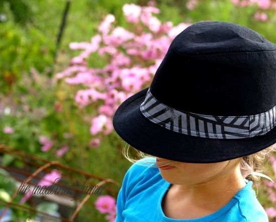 Girl black hat flower garden