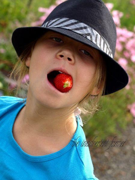 Girl strawberry hat garden