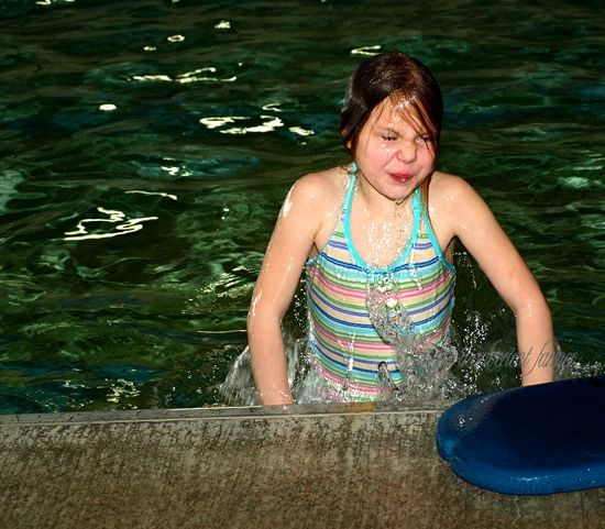 Girl swim lessons water