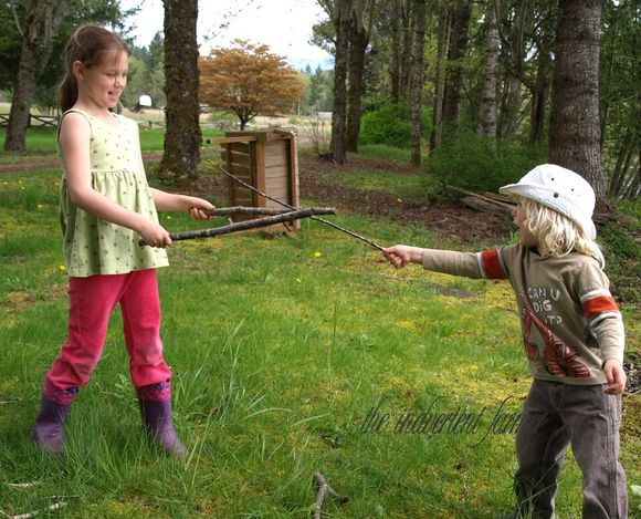 Girl boy sword fight